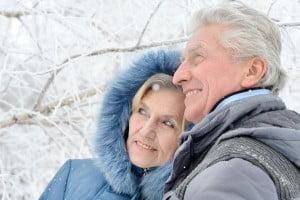 Portrait Of Elderly Couple in the snow